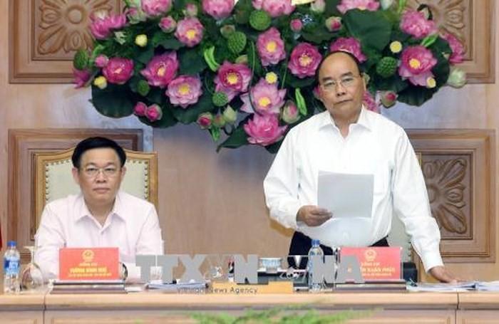 Premierminister Nguyen Xuan Phuc nimmt an der Sitzung des Nationalrats für Währungspolitik teil - ảnh 1