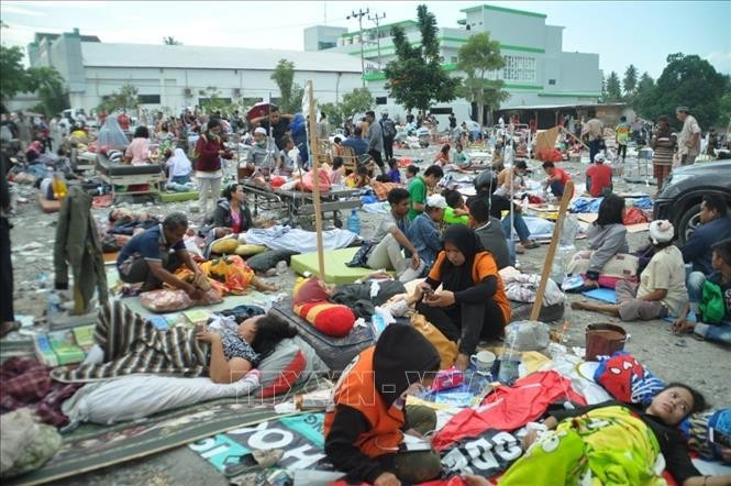 Indonesien verstärkt Rettungsarbeit nach Tsunami in Zentral-Sulawesi  - ảnh 1