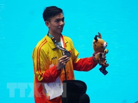 Vietnam wins first ASIAD silver medal in swimming  - ảnh 1