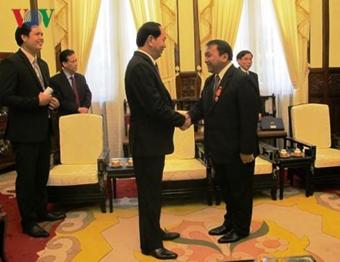 ประธานประเทศให้การต้อนรับเอกอัครราชทูตกพช. - ảnh 1