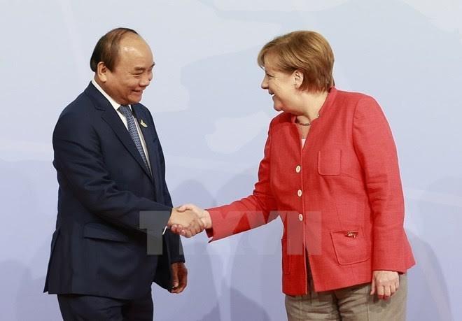 นายกฯเวียดนามเสร็จสิ้นการเยือนเยอรมนีและเข้าร่วมการประชุมจี20 - ảnh 1