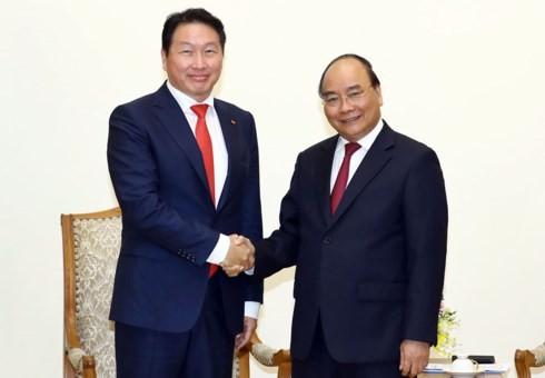 นายกรัฐมนตรีให้การต้อนรับประธานเครือ เอสเค กรุ๊ป สาธารณรัฐเกาหลี - ảnh 1