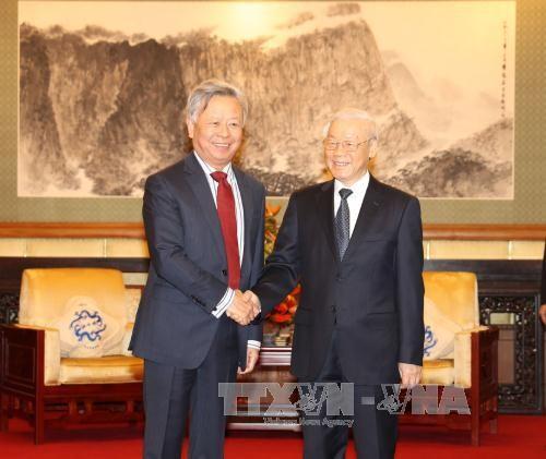 越共中央总书记阮富仲会见在越投资经营的一些中国企业家 - ảnh 1