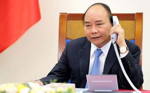 越南政府总理阮春福与丹麦首相拉斯穆森通电话 - ảnh 1