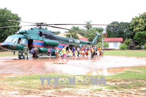 越南积极帮助老挝南部阿速坡省克服水电站大坝坍塌事故影响 - ảnh 1