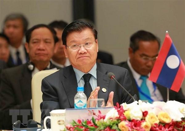 老挝总理通伦出席越南2018年世界经济论坛东盟峰会 - ảnh 1