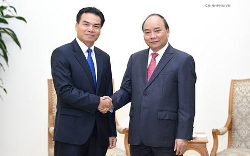 阮春福会见老挝总理府部长兼办公厅主任佩·蓬皮帕 - ảnh 1