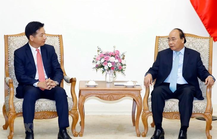 越南政府总理阮春福会见日本驻越大使梅田邦夫 - ảnh 1