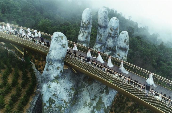 Cau Vang (Goldene Brücke) – Ein Bauwunder in Ba Na Hills - ảnh 9