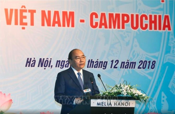Premierminister von Vietnam und Kambodscha nehmen am Forum der Unternehmer beider Länder teil - ảnh 1