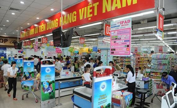 Patriotische Vietnamesen bevorzugen vietnamesische Waren - ảnh 1
