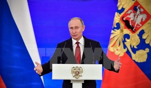 ທ່ານປະທານາທິບໍດີ Vladimir Putin ຖະແຫຼງອອກສະໝັກຮັບເລືອກຕັ້ງເປັນປະທານາທິບໍດີ ລັດເຊຍ ປີ 2018 - ảnh 1
