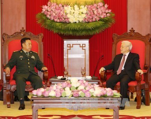 Máximos dirigentes vietnamitas reciben a alto funcionario militar de China - ảnh 1
