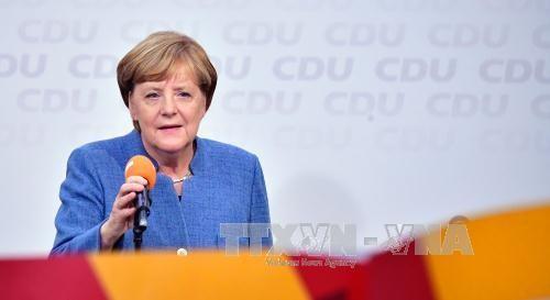 German Chancellor announces coalition talks with FDP, Greens - ảnh 1