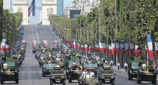 France celebrates Bastille Day with major military parade - ảnh 1