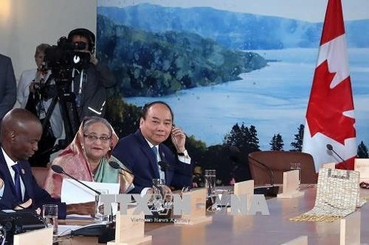 Nguyen Xuan  Phuc총리 확대 G7정상회의 참여 및 캐나다 방무 마무리 - ảnh 2