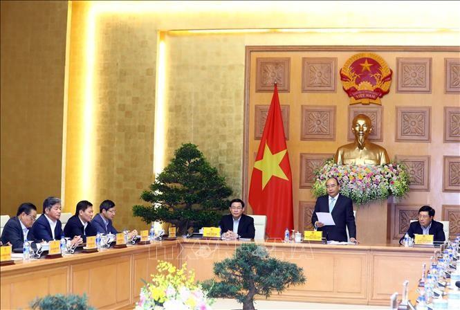 Nguyên Xuân Phuc travaille avec son groupe de consultation économique - ảnh 1