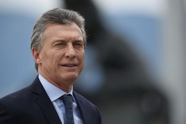 Le président argentin entame sa visite officielle au Vietnam - ảnh 1