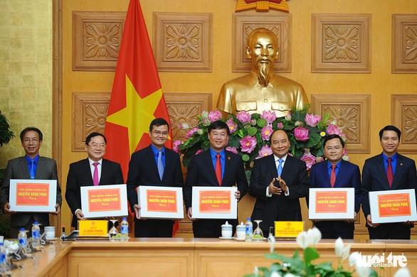 Pour une meilleure coordination entre le gouvernement et l'Union de la jeunesse  - ảnh 1