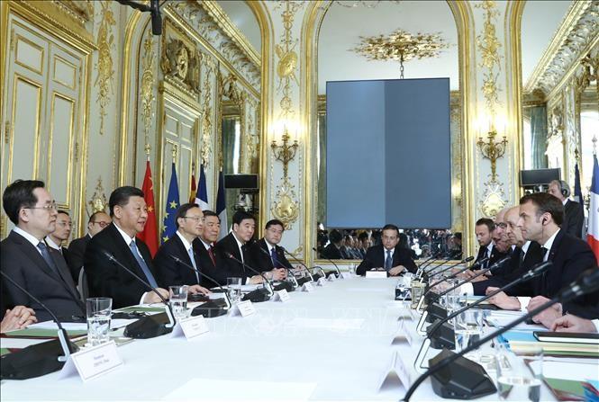 Macron et Merkel esquissent un front européen face à la Chine - ảnh 1