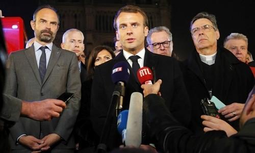 Notre-Dame de Paris : Macron promet que la cathédrale sera rebâtie   - ảnh 1