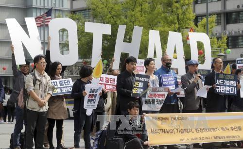 Тысячи корейцев окружили посольство США в Сеуле для протеста размещения систем ПРО  - ảnh 1