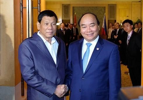 Nguyen Xuan Phuc총리와 필리핀 대통령 회견 - ảnh 1