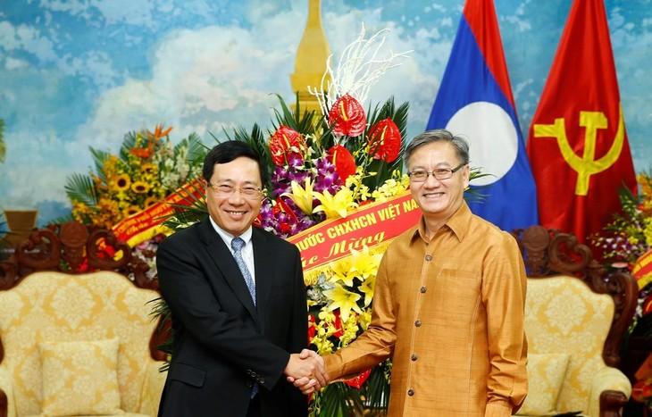 베트남 팜 빈 민 부총리, 라오스 전통 명절인 분피마이 축하 - ảnh 1
