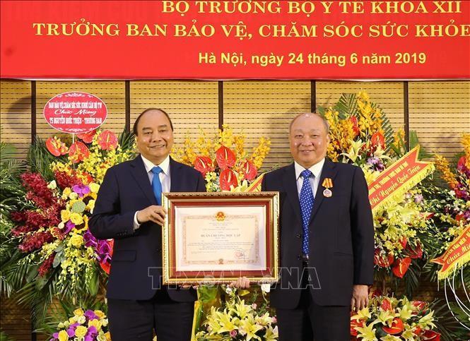 Thủ tướng Nguyễn Xuân Phúc dự lễ trao Huân chương Độc lập hạng Nhất cho ông Nguyễn Quốc Triệu - ảnh 1