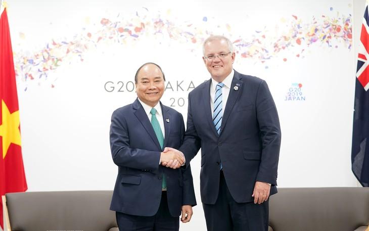 Thủ tướng Nguyễn Xuân Phúc thảo luận giải pháp tăng cường hợp tác song phương với với lãnh đạo các nước dự G20 - ảnh 2