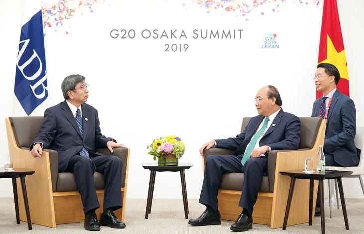 Thủ tướng Nguyễn Xuân Phúc thảo luận giải pháp tăng cường hợp tác song phương với với lãnh đạo các nước dự G20 - ảnh 3