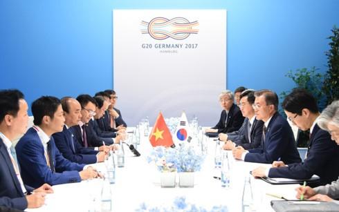Премьер Вьетнама встретился с лидерами G20 в Гамбурге - ảnh 1