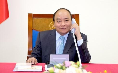Премьер-министр Вьетнама провел телефонный разговор с японским коллегой - ảnh 1
