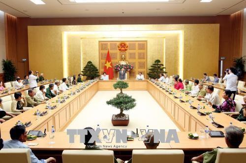Партия и государство Вьетнама всегда проявляют заботу о гражданах, имеющих заслуги перед Отечеством - ảnh 1
