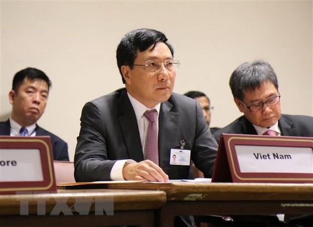 Вице-премьер, глава МИД СРВ Фам Бинь Минь выступил на 17-м саммите Франкофонии - ảnh 1
