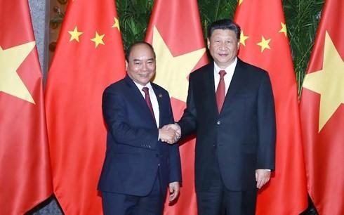 Премьер Вьетнама встретился с генсеком ЦК КПК, председателем КНР - ảnh 1