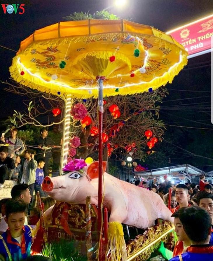 Обряд шествия с «господином Свинья» в деревне Лафу - ảnh 3