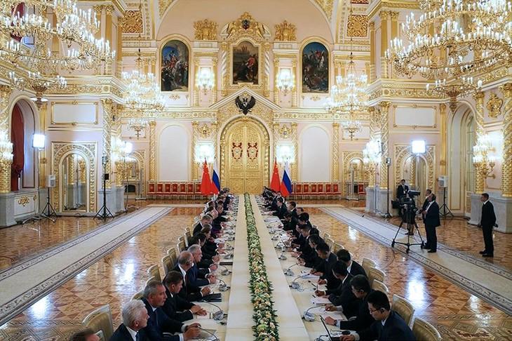 Лидеры России и Китая договорились поднять уровень двусторонних отношений - ảnh 2