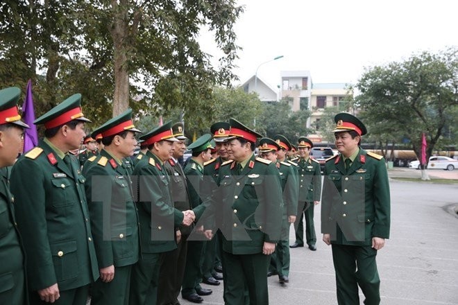 Ngo Xuan Lich rend visite à la division 341 - quatrième zone militaire - ảnh 1