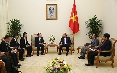 Le ministre laotien de l'Energie et des Mines reçu par le Premier ministre vietnamien - ảnh 1
