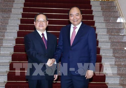 Nguyên Xuân Phuc reçoit le secrétaire du PCC pour la région autonome zhuang - ảnh 1