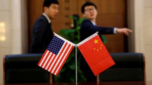 Washington et Pékin poursuivent le dialogue dans l'ombre des tarifs douaniers - ảnh 1