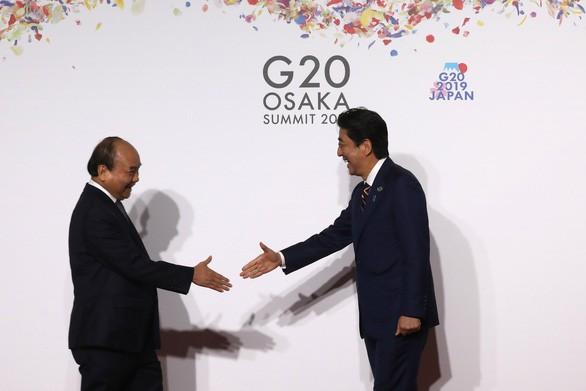 Sommet du G20: suite des activités de Nguyên Xuân Phuc - ảnh 1