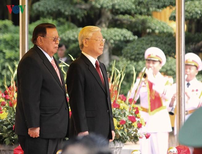 Lễ đón chính thức Tổng Bí thư, Chủ tịch nước Lào tại Hà Nội - ảnh 6