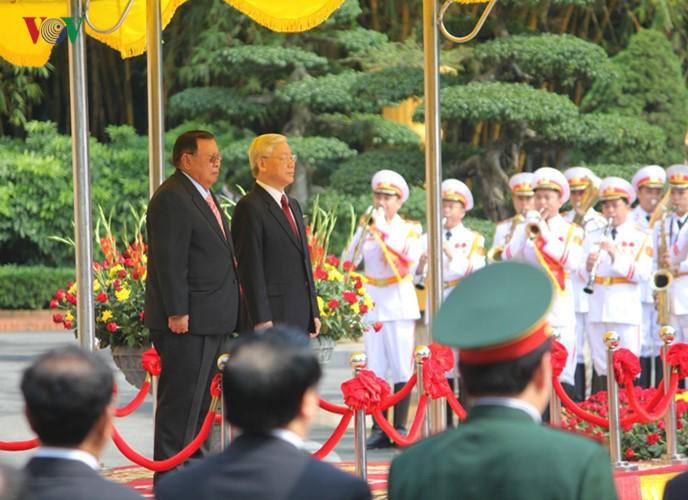 Lễ đón chính thức Tổng Bí thư, Chủ tịch nước Lào tại Hà Nội - ảnh 4