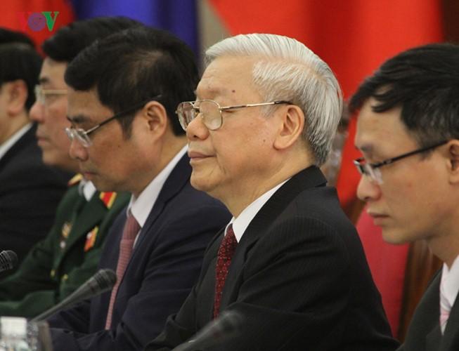 Lễ đón chính thức Tổng Bí thư, Chủ tịch nước Lào tại Hà Nội - ảnh 11