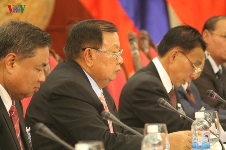 Lễ đón chính thức Tổng Bí thư, Chủ tịch nước Lào tại Hà Nội - ảnh 12