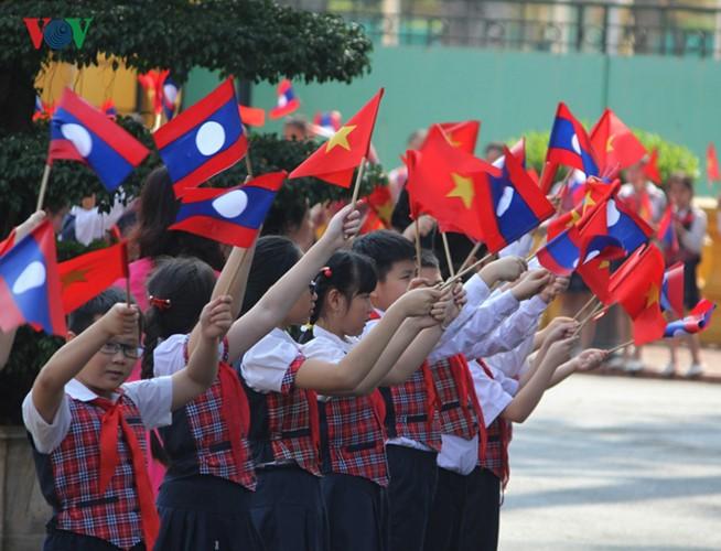 Lễ đón chính thức Tổng Bí thư, Chủ tịch nước Lào tại Hà Nội - ảnh 3
