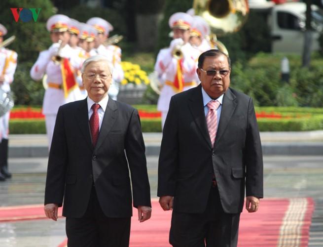 Lễ đón chính thức Tổng Bí thư, Chủ tịch nước Lào tại Hà Nội - ảnh 9