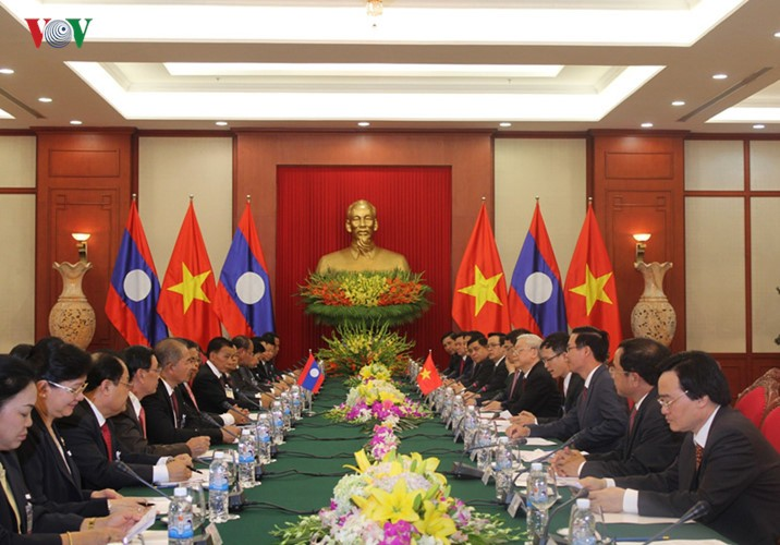 Lễ đón chính thức Tổng Bí thư, Chủ tịch nước Lào tại Hà Nội - ảnh 10